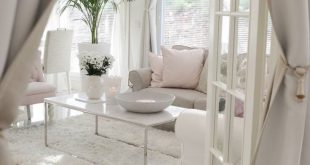 Shows white floors and muted pops of color.